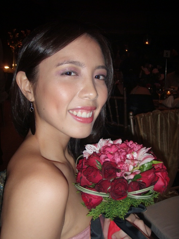 Noelle, catcher of the bridal bouquet